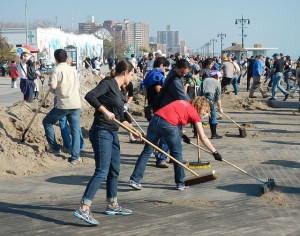 Volunteers clean up the Brooklyn boardwalk after Hurricane Sandy in 2012. Photo by Wikipedia