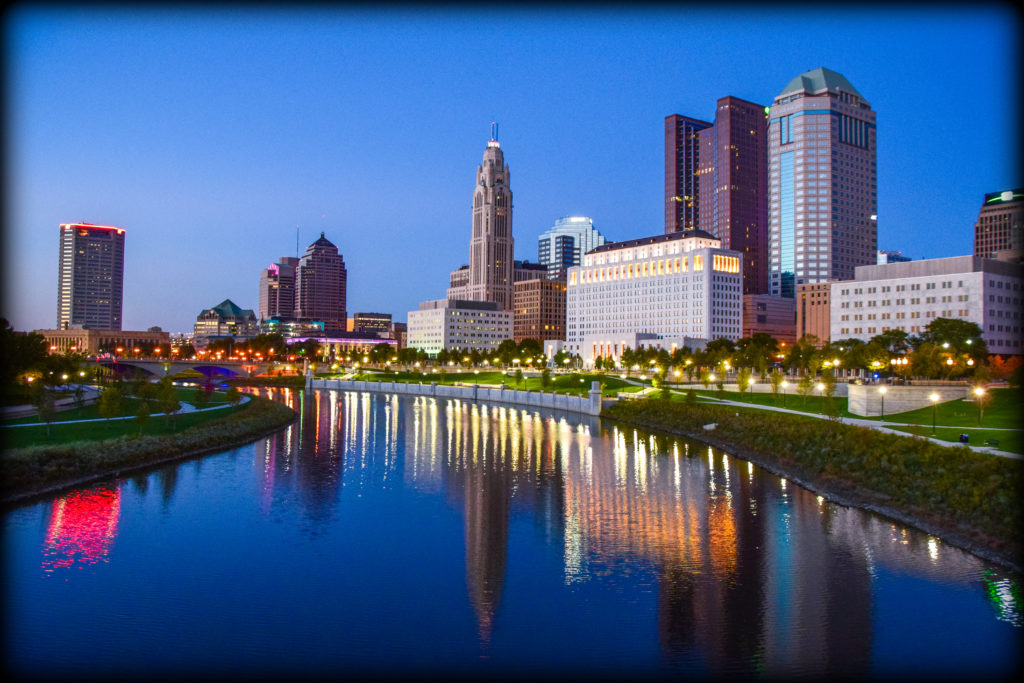 Downtown Columbus, Ohio during beautiful summer sunset. Columbus is the capital of Ohio and largest city of Franklin County. Note: all logos have been blurred in the logo per iStock guidelines for royalty-free submission.